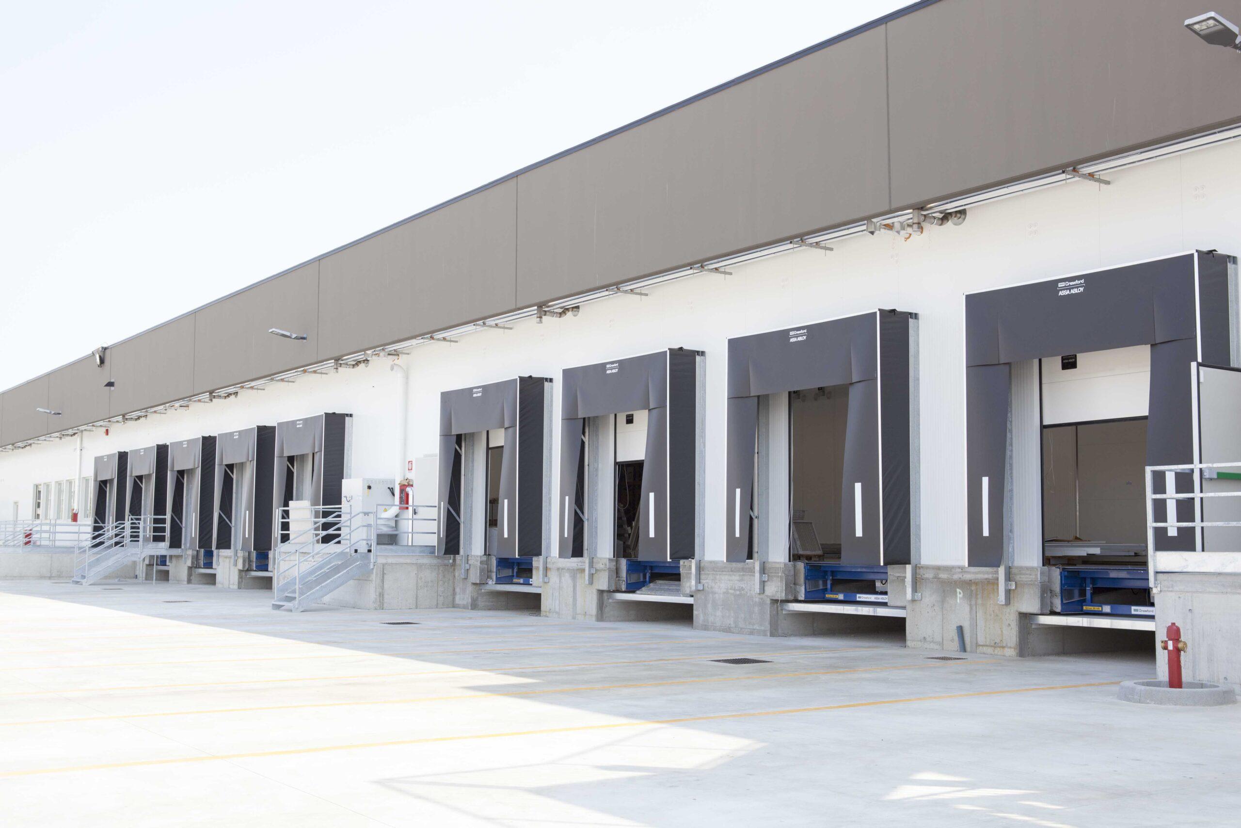 Baie di carico immobile completato Comavicola | SQM Real Estate miglior agenzia immobiliare per aziende industria terreni logistica sviluppo immobiliare