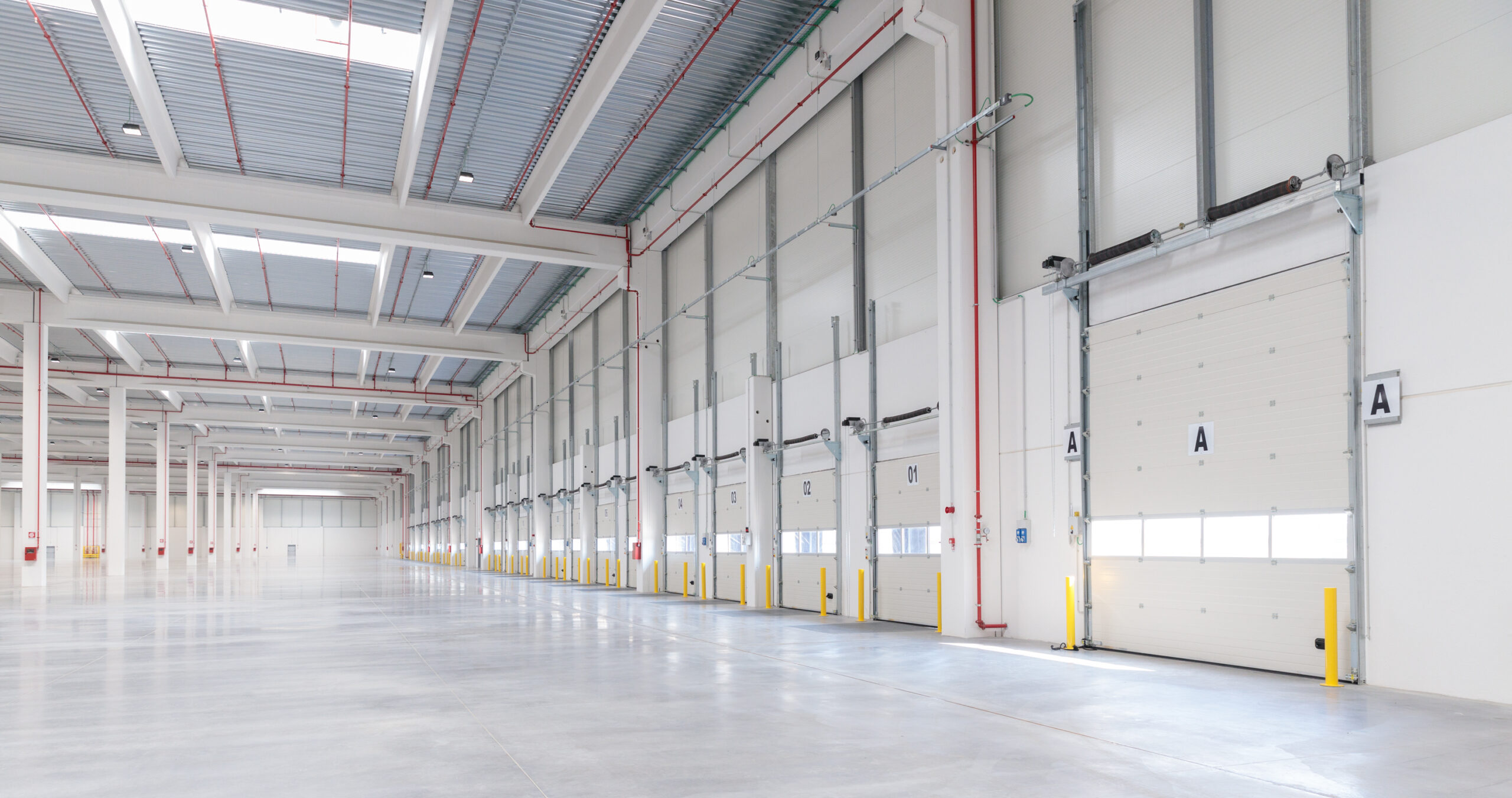 Vista interno magazzino logistico - CARLYLE Mesero | SQM Real Estate miglior agenzia immobiliare per aziende industria terreni logistica sviluppo immobiliare
